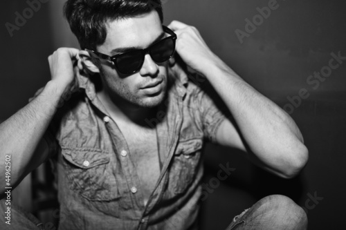 Vintage stylized black and white photo of young male model