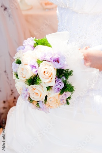 wedding bouquet at bride's hands