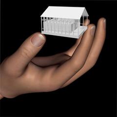 mano mostra casa in costruzione