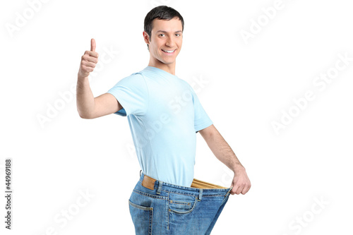 A weight loss male with thumb up