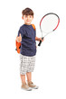 Child holding a tennis racket and giving thumb up