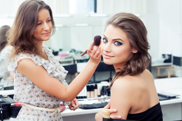Make-up artist applying powder