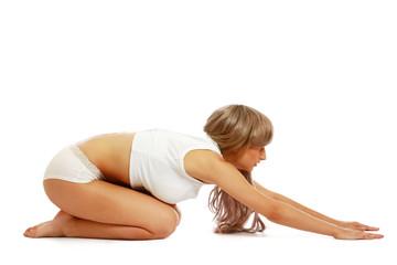 Woman in underwear in yoga pose.