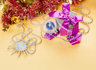 Christmas decorations composition with present on yellow backgro