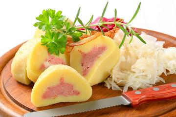 Meat stuffed potato dumplings with shredded cabbage
