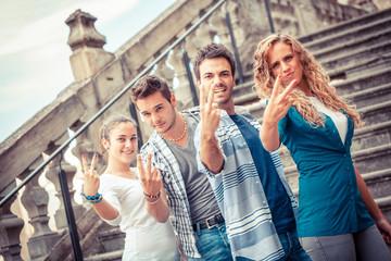 Group of Friends showing Obscene Gesture