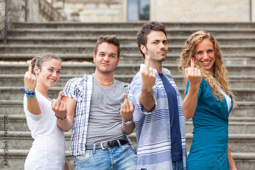 Group of Friends showing Obscene Gesture