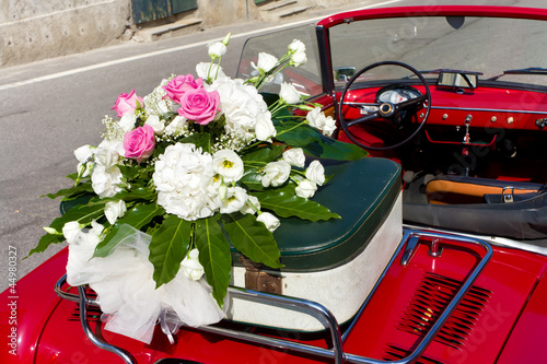 floral wedding bouquet on vintage car