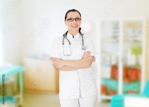Beautiful woman in medical uniform and stethoscope.