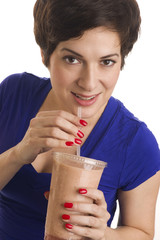 Woman sips Flesh Tone Smoothie