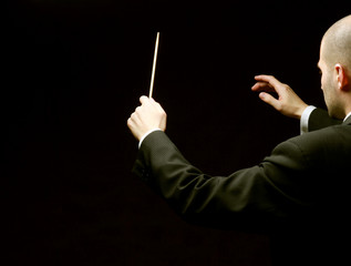 A concert conductor with a baton