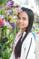 asian woman portrait with orchid flower