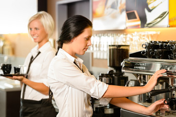 Staff at cafe making coffee espresso machine