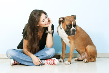 Pretty woman playing  with her beautiful Boxer Dog.