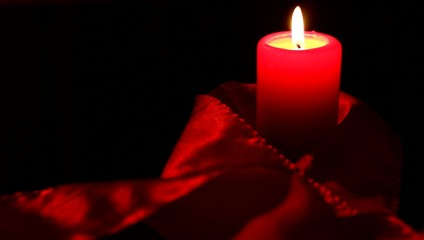 Red candle and silk.