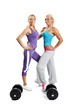 Two muscle women posing on a white background with dumbbells