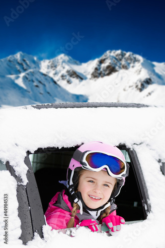Winter holiday - happy child on the road for winter holidays