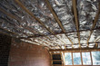 Fibreglass insulation installed in the sloping ceiling of a hous