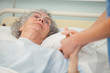 Nurse caring about old woman