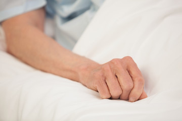 Elderly arm in hospital bed