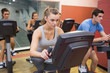 People working out at spinning class
