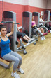 Women training in weights room