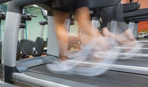 People jogging on a treadmill