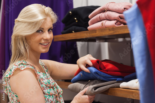 Woman standing by the shelf searching
