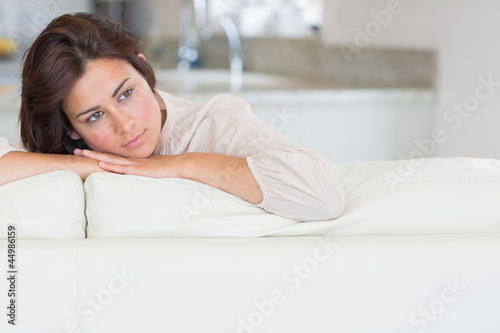 Thoughtful woman relaxing on the couch