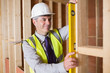 Architect measuring wood frame