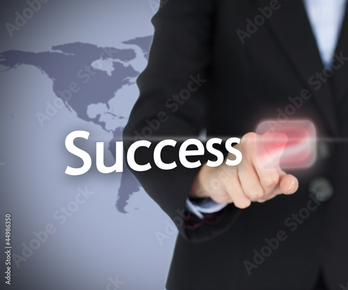 Businesswoman touching on the success button
