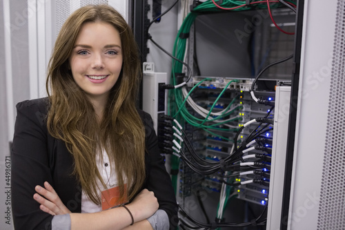 Girl standing in front of rack mounted servers