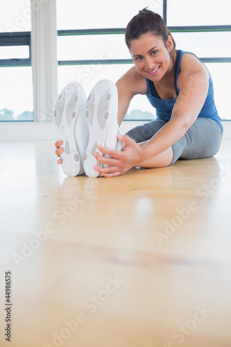Happy woman stretching legs