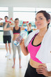 Woman drinking water at aerobics class