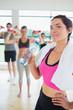 Woman drinking water at aerobics class