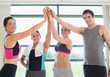 Smiling people high fiving each other in gym