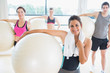People holding exercise balls