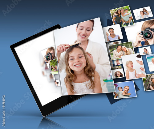 Tablet computer showing many family images
