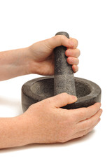 Pestle and nortar grinding