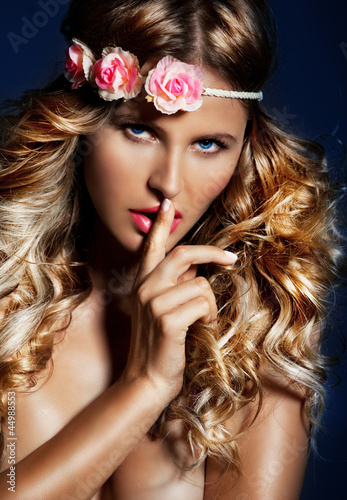 Woman with long Shiny hair and  flowers on head, Hush babe.