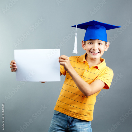 Schoolboy with blank paper