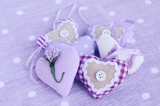 Decorative lavender hearts on lavender background