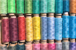 Colorful bobbins of thread as backgrou