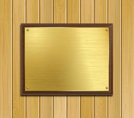 Brass Plaque on Wood Panel Background