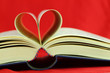 Selective focus image of book pages folded into a heart shape