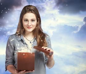 Beautiful Woman Opening a Gift Box