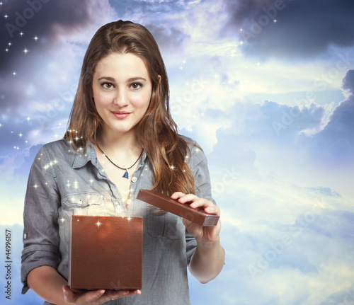 Beautiful Woman Opening a Gift Box