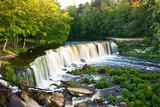 Beautiful waterfall called Keila Juga in summer in forest
