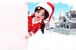 santa girl with sign near buildings