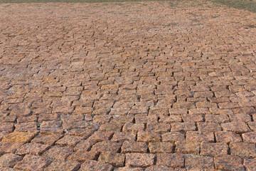 Granite brick road natural stone background close up